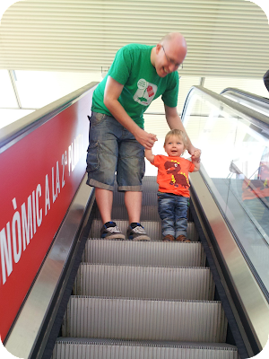 first time on an escalator, father and son moments