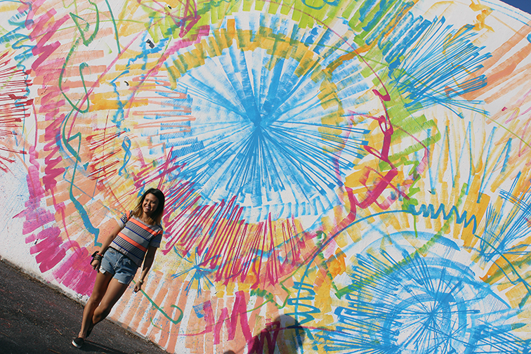 Lisa Tam from MIMO Market in front of a street art mural in Wynwood