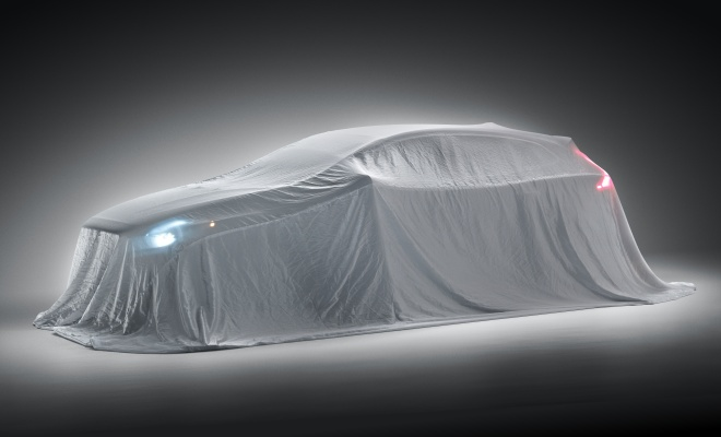 Volvo V40 covered with a silk sheet