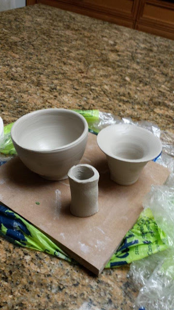 Pieces of a ceramic goblet in progress.