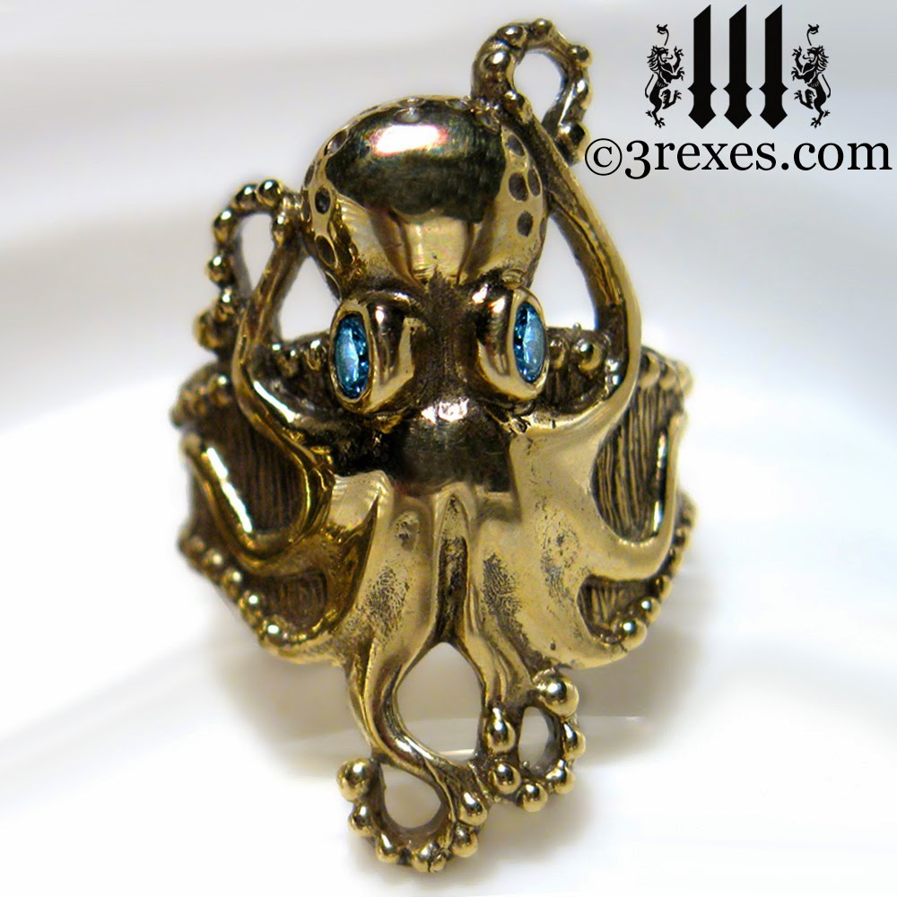 brass octopus ring with blue topaz eyes