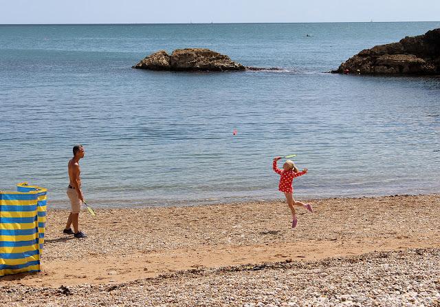 beach-badminton-flying-girl-lulworth-cove-sea-level-todaymywayblog