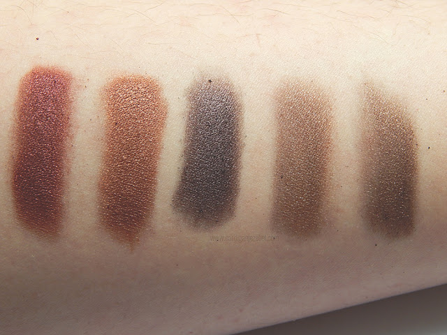 Five eyeshadows swatched on someone's arm