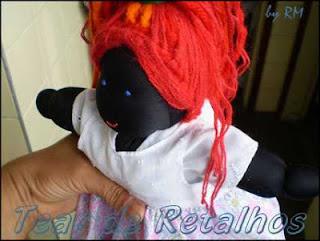 Uma boneca de pano muito sapeca chamada Maria Rita.