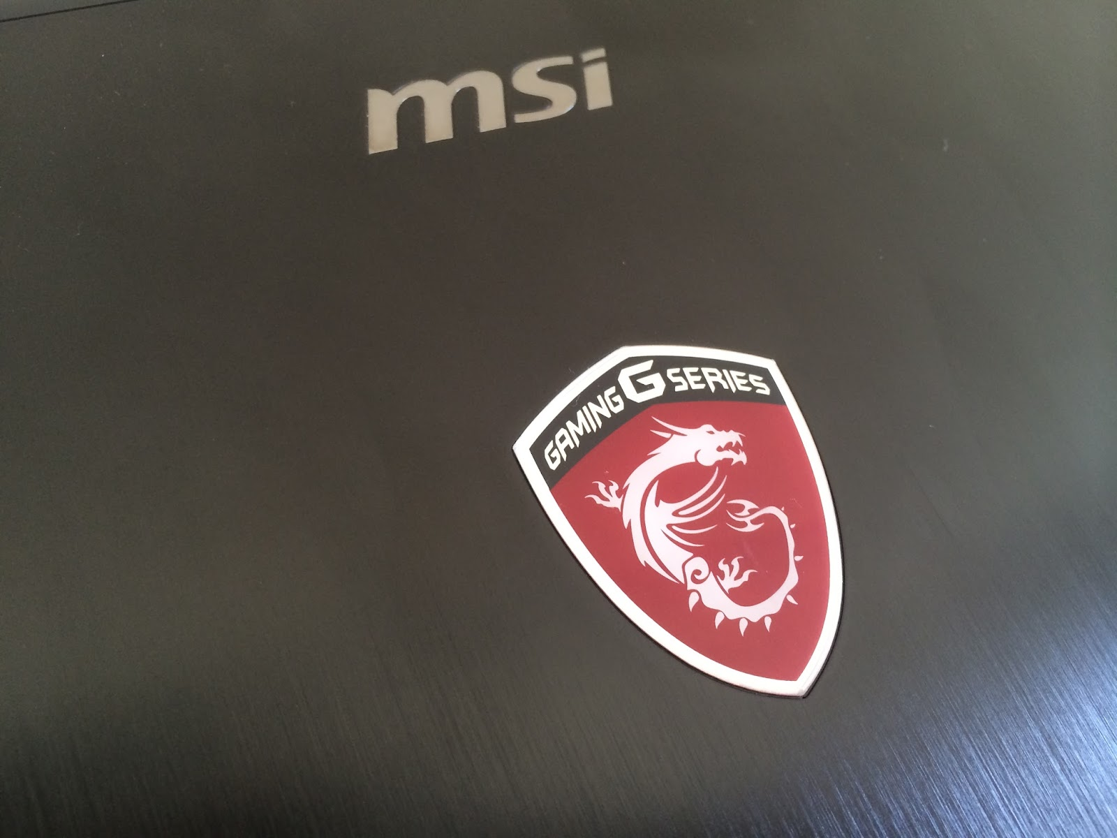 Msi g series wallpaper notebookreview - Aside Of The Brushed Metal Texture Lid The Glowing Msi Dragon Also Gives An Additional Premium Feel Of A Gaming Notebook