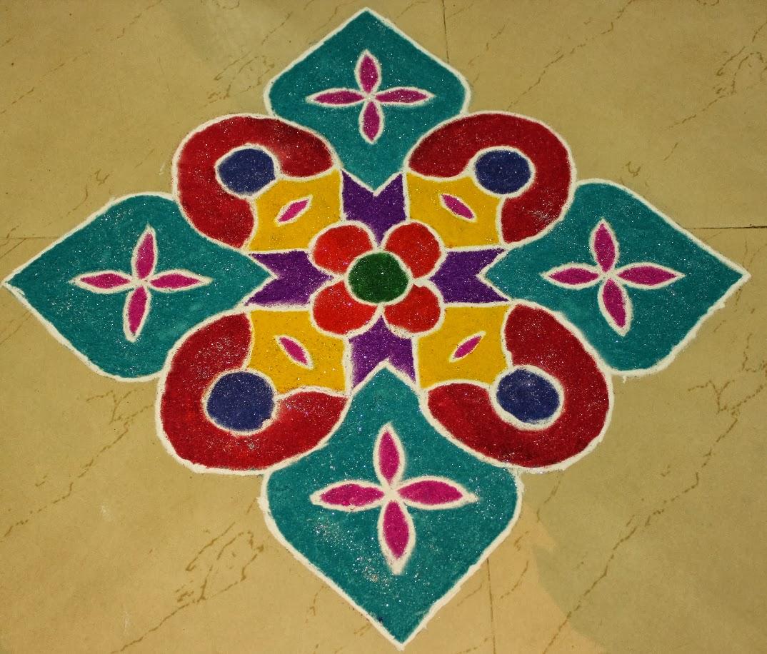 Colorful rangoli painting for diwali home decoration for Home rangoli designs