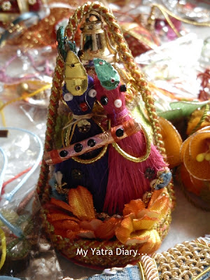 Lord Krishna coconut decorative given as gift to sisters in law during Raksha Bandhan
