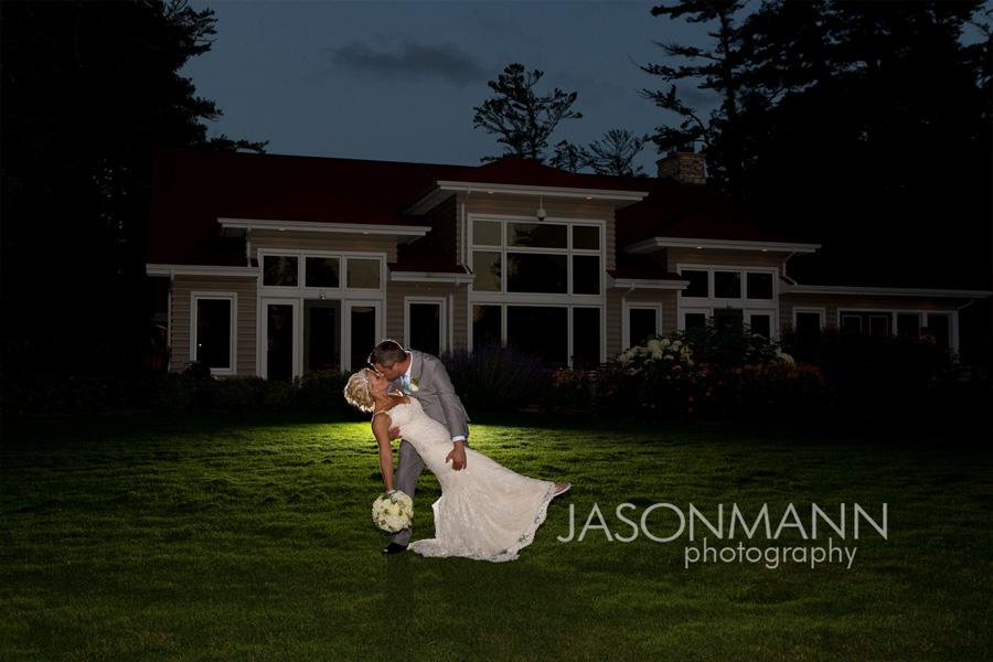Gordon Lodge wedding couple; romantic dip kiss at night. Photo by Jason Mann Photography, 920-246-8106, www.jmannphoto.com