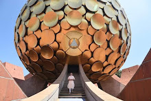 'May Auroville serve as a beacon to the world'