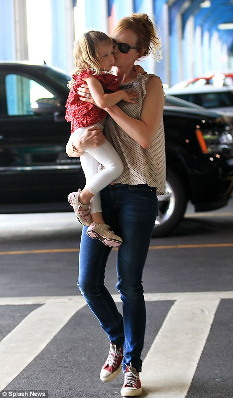 Nicole Kidman and Keith Urban bowled over by their adorable girl Sunday Rose as she's smothered in kisses