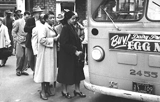Photo: Rosa Parks boarding bus after Montgomery Bus Boycott