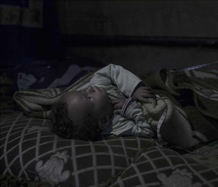 Photographer Reveals The Heartbreaking Places Syrian Refugee Children Sleep - Amir, 20 months, Zahle Fayda