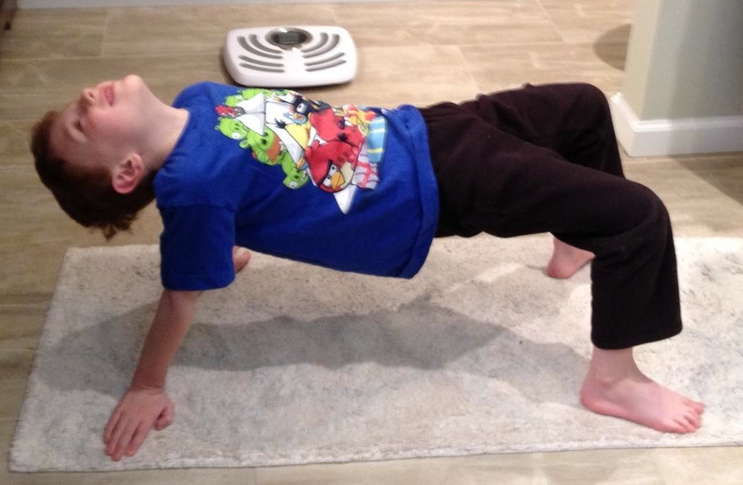 Ohmazing kids yoga yoga kid of the month for Table yoga pose