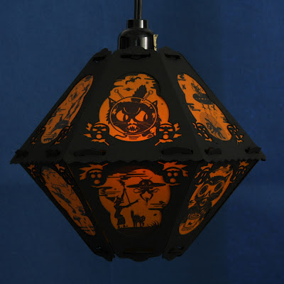 Vintage style Halloween lantern by Bindlegrim features witches and cats in outer space