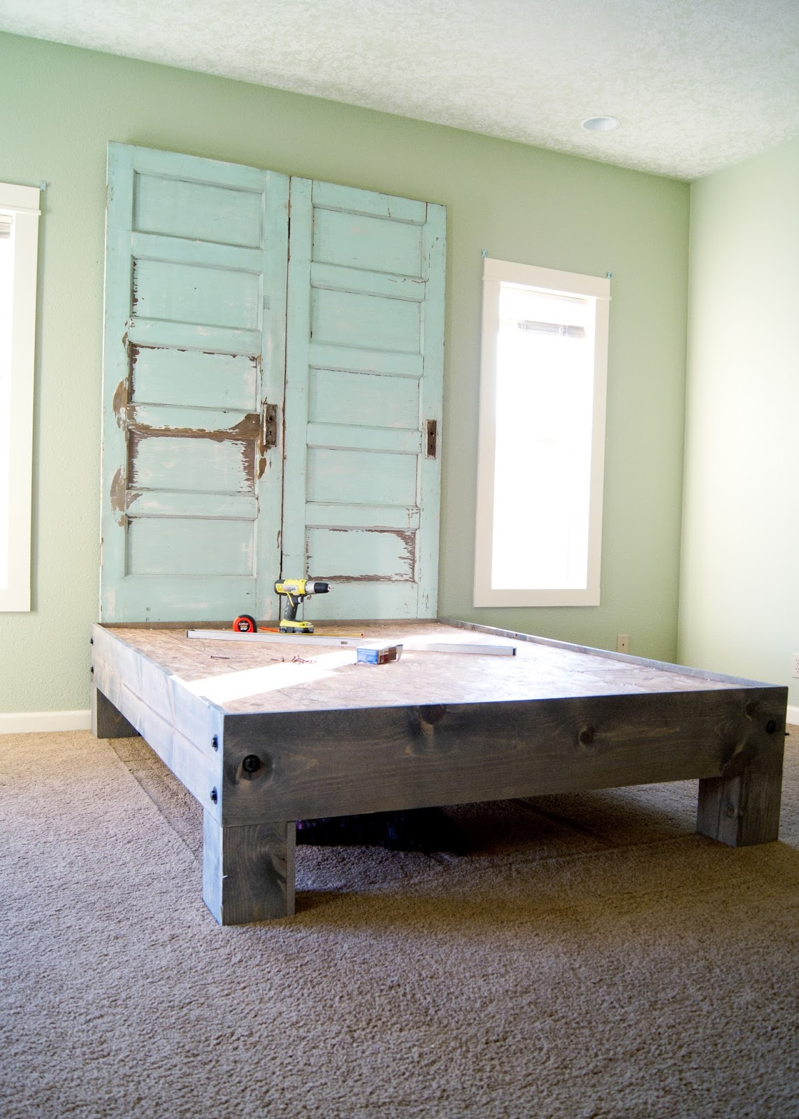 Old door headboard and platform bed