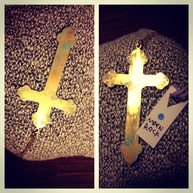 Moon Rock painted gold cross at the Gypsy Night Market Vintage sale at the fortune sound club in Vancouver