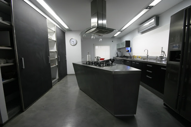 Modern black kitchen in the Waterfall House