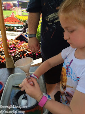 child working on sand art at Epcot International Flower and Garden Festival