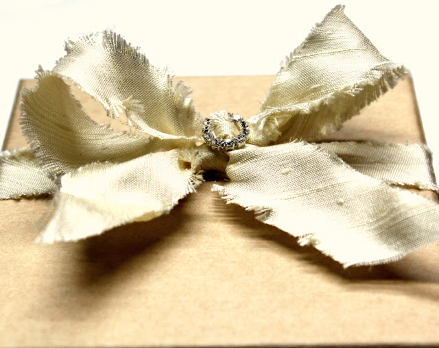 silk ribbon and rhinestone detail packaging