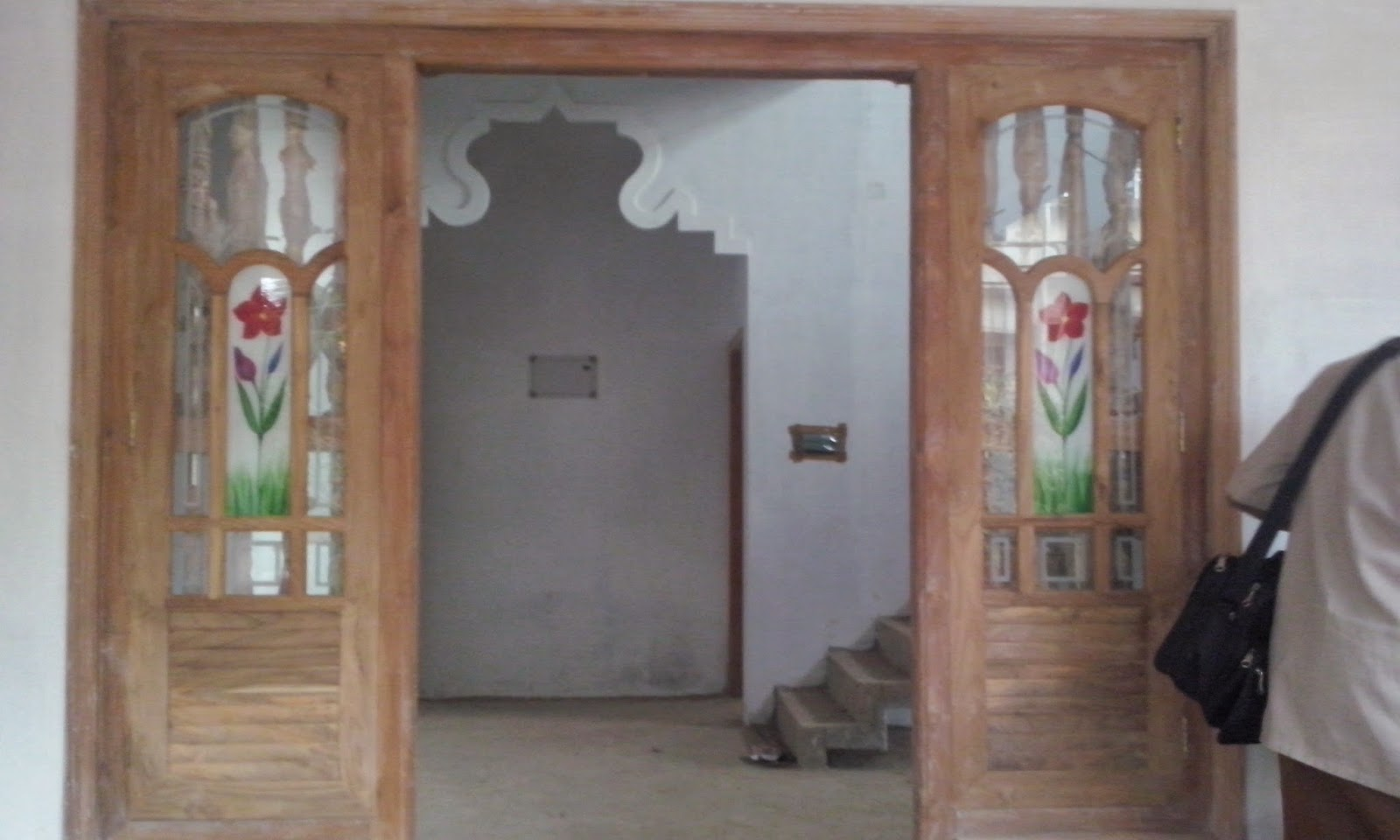 Kerala style carpenter works and designs february 2015 for Wood doors with windows