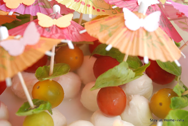 tomato mozzarella basil skewers with butterflies on the umbrellas