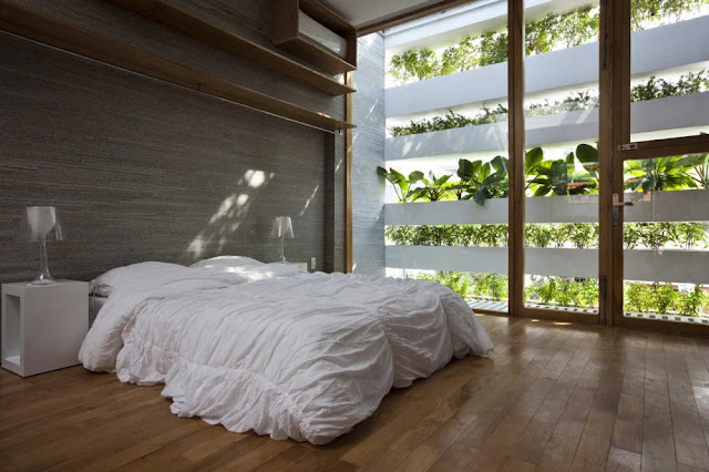 Photo of bedroom by the facade with vegetation