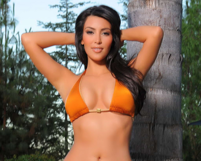 Kim Kardashian in orange bikini