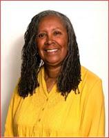 headshot of Marion Coleman wearing yellow shirt