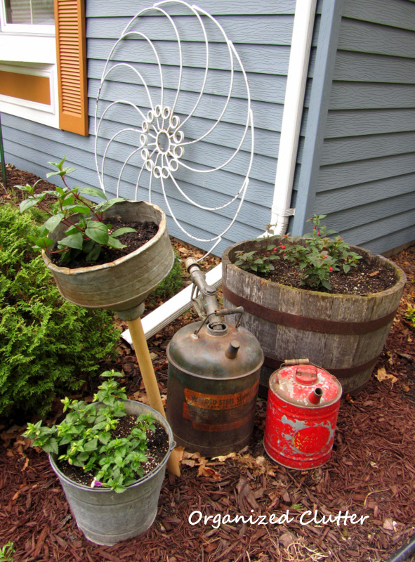 Gas Cans, Funnel, Bucket and Fuchsias www.organizedclutterqueen.blogspot.com