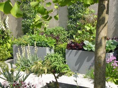 Tuindesign 20 tips en tuinidee n voor een kleine tuin met for Mooie voortuinen foto s
