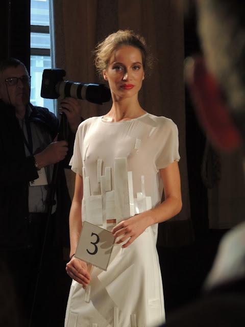 Model in white chiffon dress with rectangular patent panels