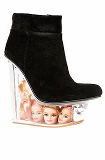 http://www.karmaloop.com/product/The-Icy-Shoe-in-Black-Suede-and-Doll-Heads/389683