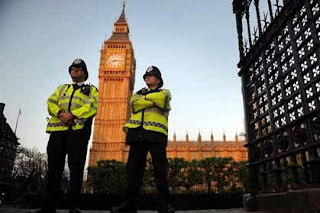 Police officers outside the Houses of Parliament, London