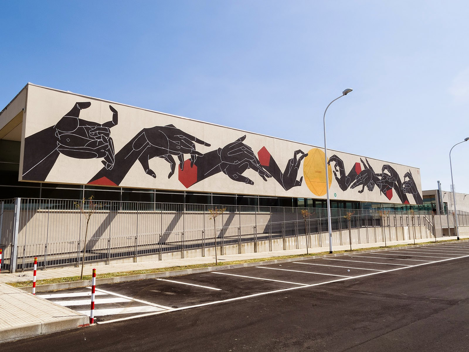 Our friend Basik just sent us a series of images after he spent month in Sicily for an artist residency organized by the I ART program. The Italian artist was  located in the town of Misterbianco, very close to mount Etna, where he managed to create a mural on the local auditorium.