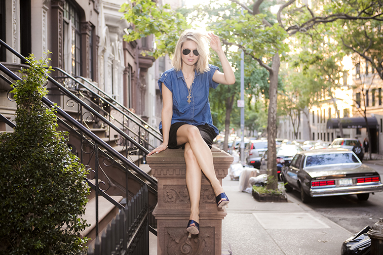 Hair twirling on the Upper West Side, tree-lined street, beautiful row of brownstones, summer chillin, denim & black outfit, satin mules