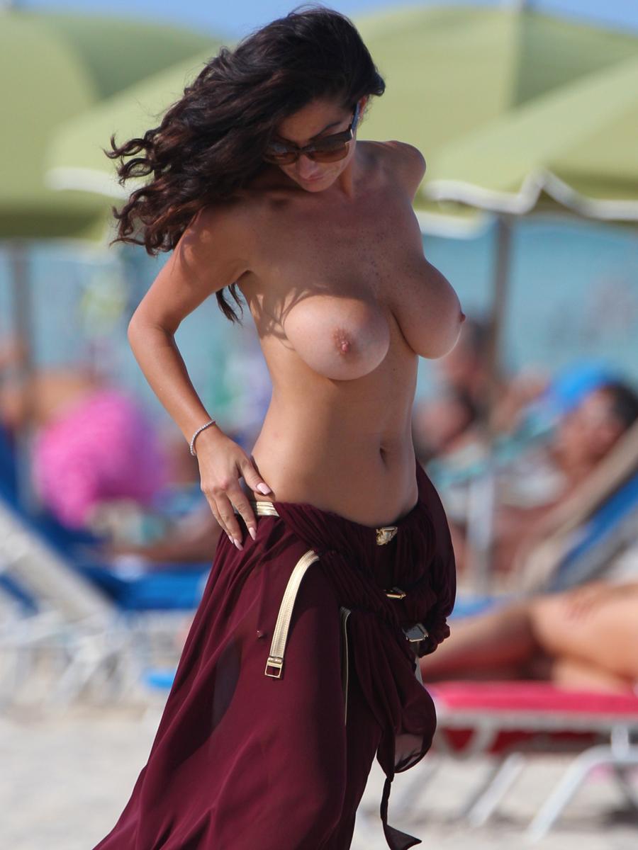 Huge fake boobs at the beach
