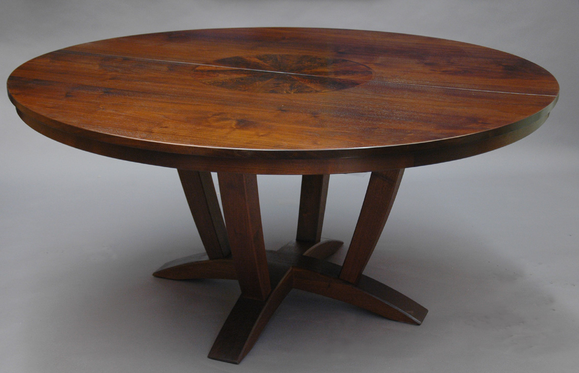 A Round Expanding Walnut Dining Table