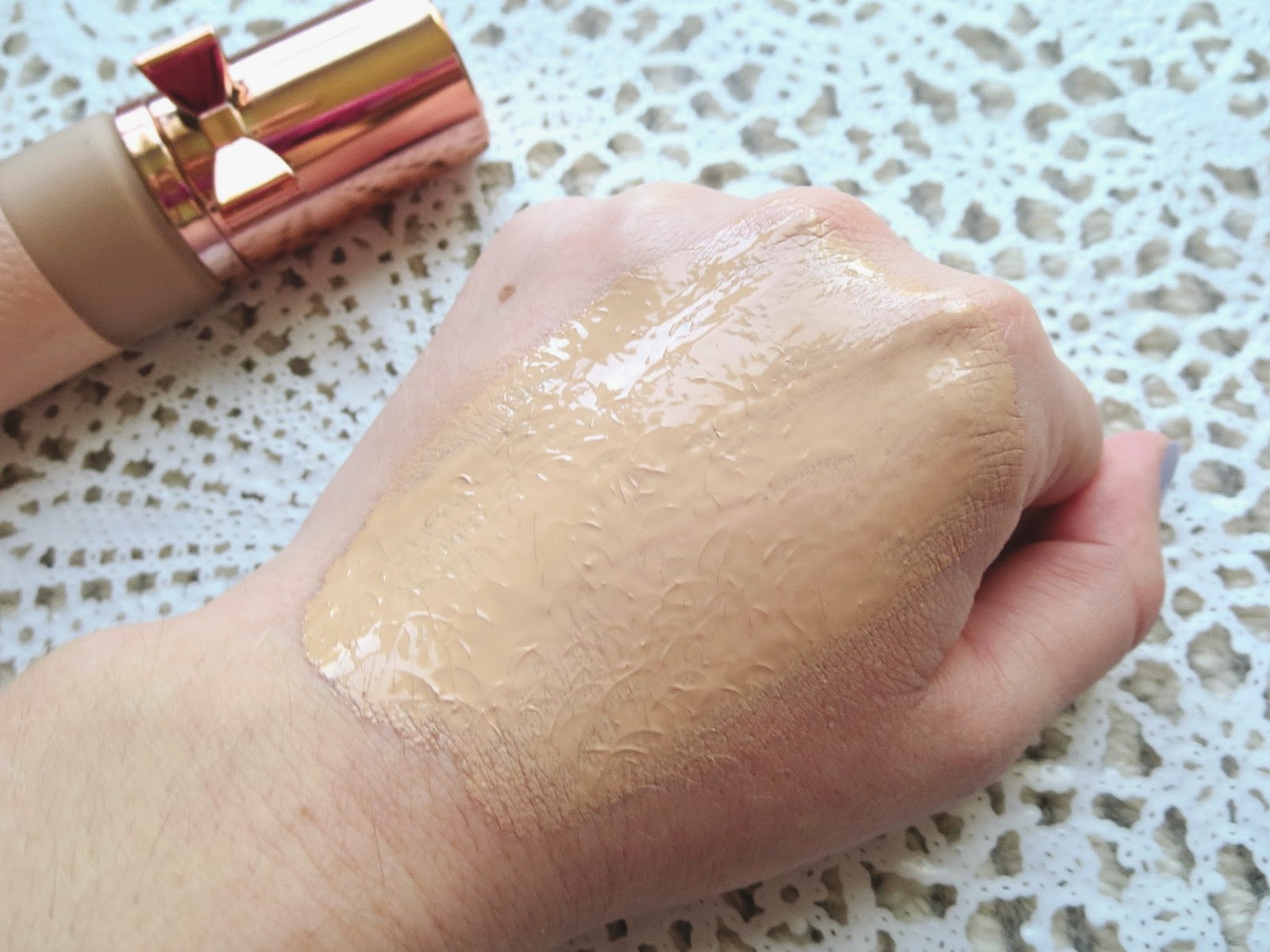 a picture of Physician's Formula Touch of Glow Foundation in Light (swatch) spread out