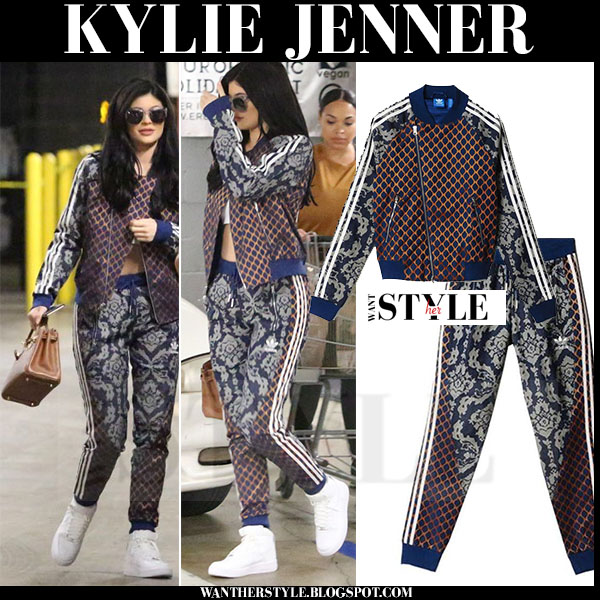 Kylie Jenner in multi print Adidas tracksuit and white Nike sneakers what she wore