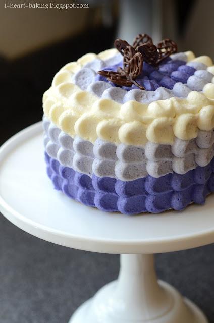 Heart baking purple ombre petal cake with chocolate butterflies