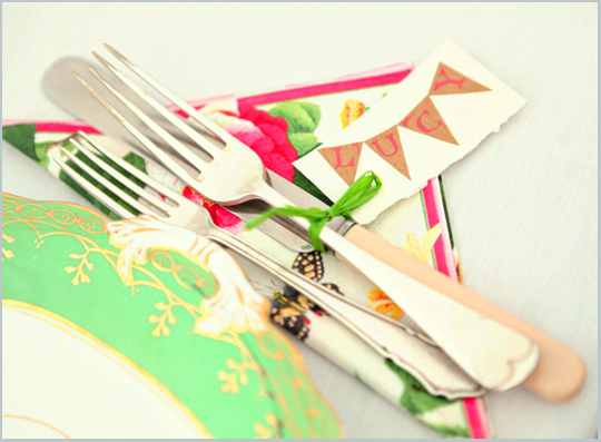 green vintage plate, silver cutlery and floral napkin