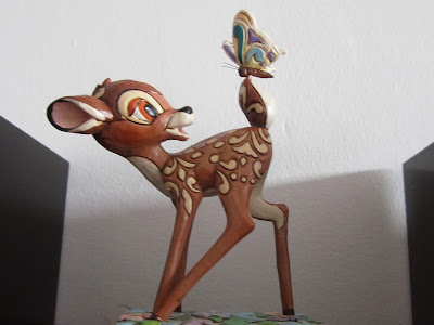 deer with butterfly on tail
