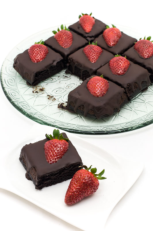 Chocolate strawberry cubes dark chocolate one cube on a plate