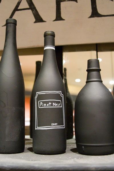 DIY Chalkboard Paint Ideas. I love this idea for spray painting wine bottles and then personalizing them with a faux label or design. These DIY chalkboard paint bottles can be used simply as decorative home accent pieces, vases for your favorite flowers or even as pricing structures for store products.