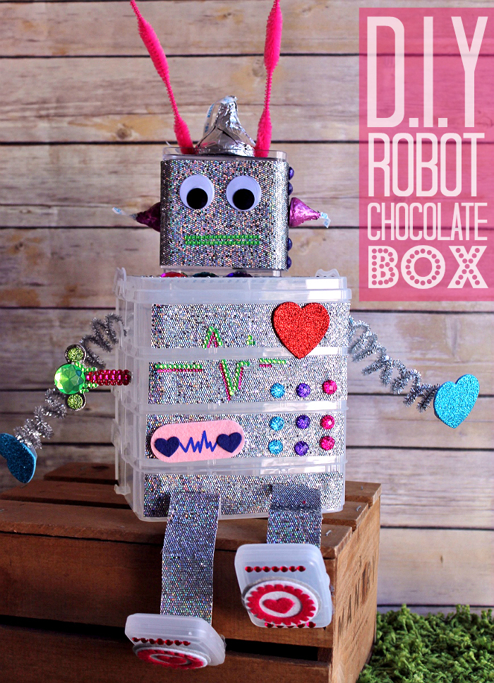 A bead organizer and a lot of bling makes for one adorable Valentine's Day gift box! Share Valentine's Day with the youngest members of your family- Make a Nerd Love gift basket for the tween in your life, or a DIY Robot Chocolate Box filled with Hershey's candy favorites. #HSYMessageOfLove #Sponsored