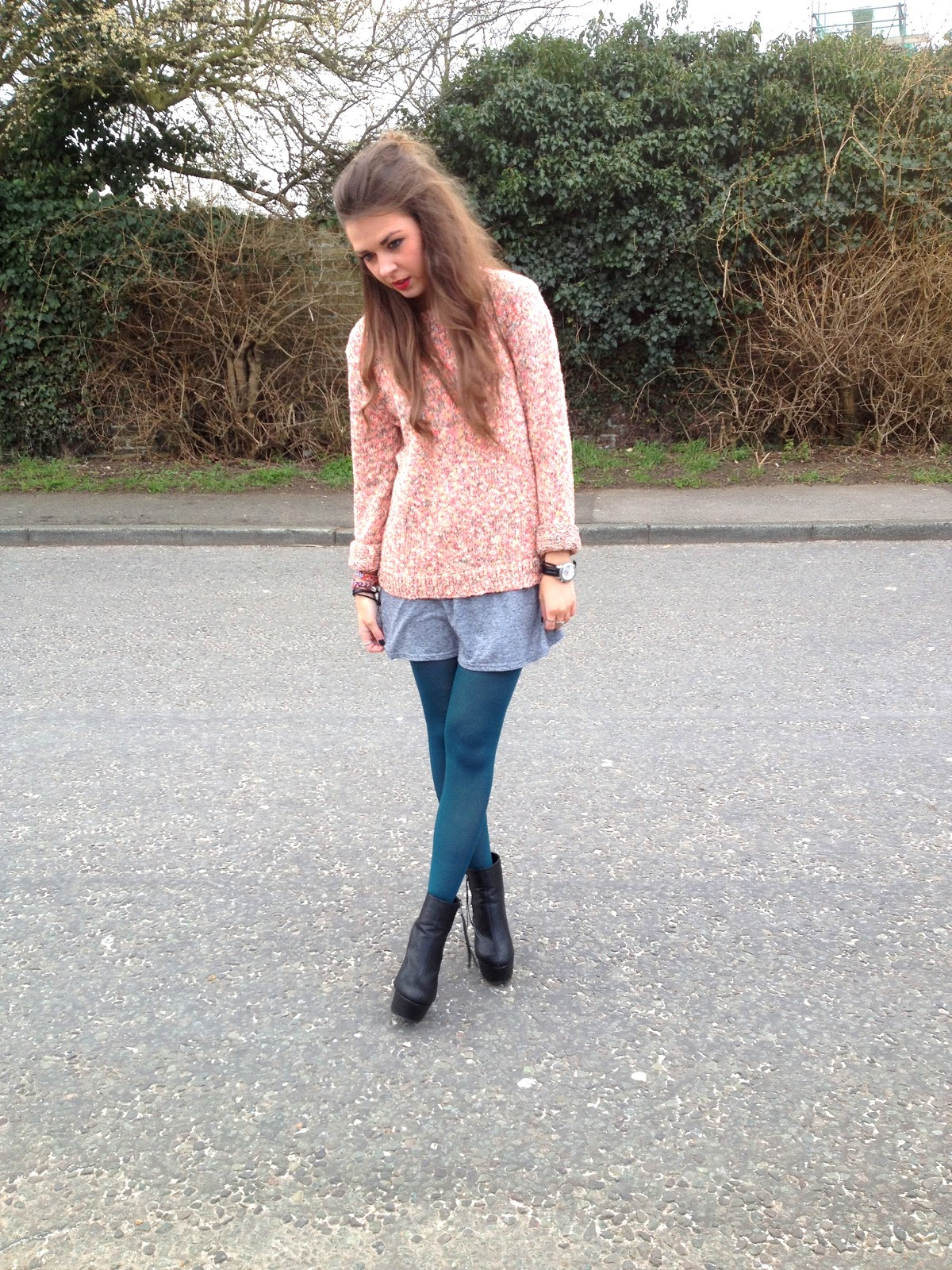 Blogger wearing oversized jumper with heels from Schuh and green tights
