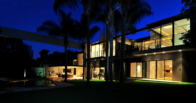 Picture of renovated house as seen at night from the backyard