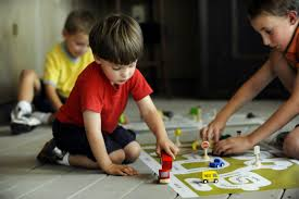 Picture of children playing with cars