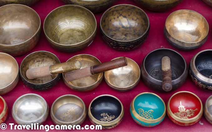 This is again a photograph from Mcleodganj but shot outside the famous temple of His Holiness Dalai Lama. This Photograph shows Singing/Meditation Bowls of different sizes in Mcledoganj Market. These are one of the famous shopping item around Mcledoganj streets and Bhagsu Waterfalls. I have been to Mcledoganj many times but during last visit I got to know about these wonderful pieces of metal which create nice sounds with vibration on rubbing a wooden stick against it's top edge. I have got one and with practice, I am able to get wonderful sounds of of it.