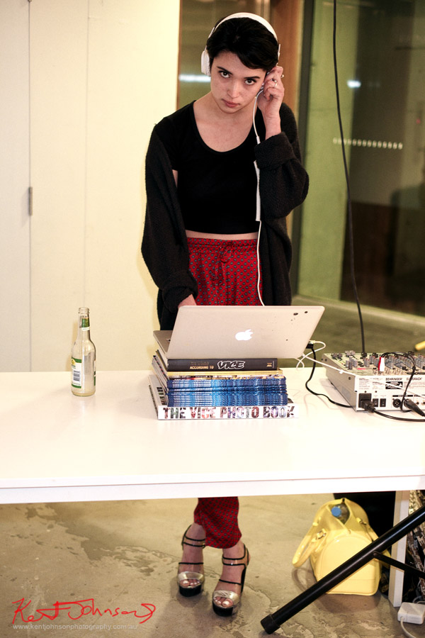DJ with laptop on a stack of VICE Magazines,  Richard Kern Exhibition Sydney -VICE Mag - Street Fashion Sydney.